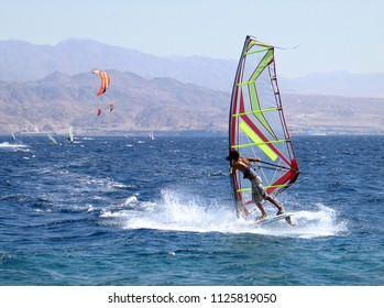 Young man is surfing on the Red sea, Eilat