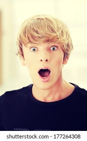 Young man with surprise expression on his face