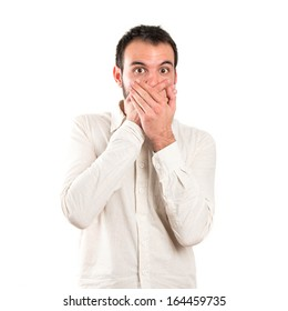 Young man surprised over white background