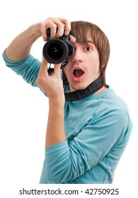 Young man surprised with photo camera. Front view. Isolated on white