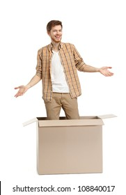 Young man is surprised why he is inside the box, isolated, white background