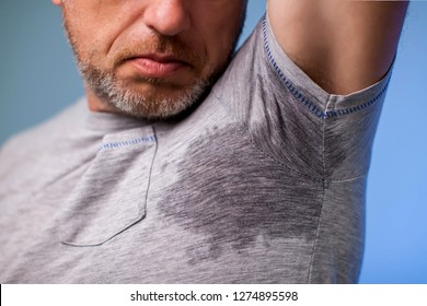 c8965df31 Young man with sweat under the armpit and have a foul odor. People, health