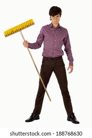 Young man with swiping brush.