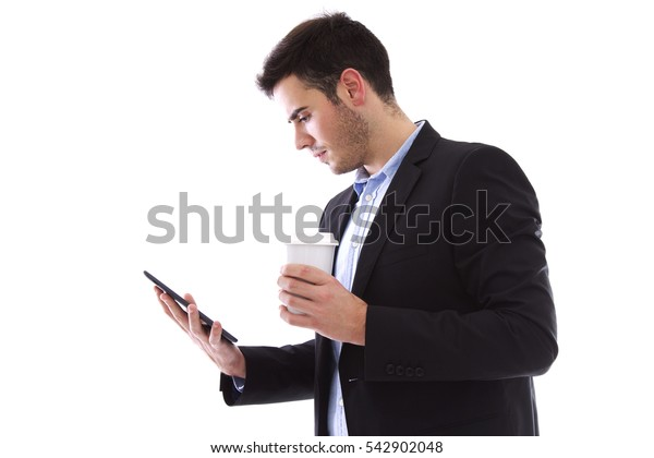 young man with the tablet and drinking a coffee
