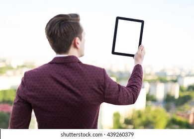 young man with a tablet in his hands