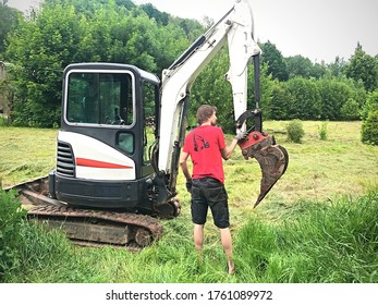A young man taking care of his digger