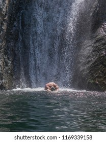 A young man, taking an dive, just under the Fonias waterfall, at Samothrace, Greece