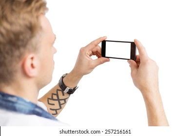 Young man taking photo with mobile phone, isolated on white background for you own image.