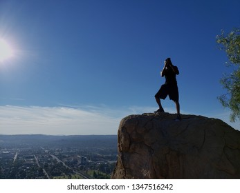 young man taking a selfie t the peak of Mount Rubidoux showing the city of Riverside ,California.september 30,2018
