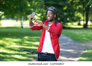 young man taking a selfie while out cycling.