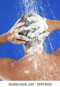 Young man taking a shower. young man washing his hair.