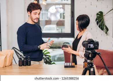 young man is talking about advantages of a natural cosmetics on the camer. secrets of beautiful face