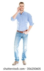 young man talking on the phone - full length shot isolated