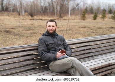 Young man talking with a smartphone outdoors