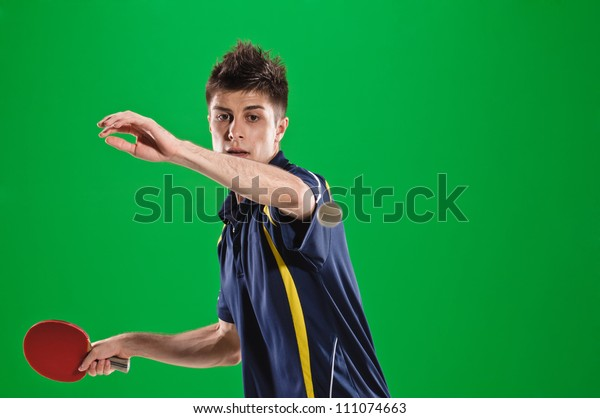 young man tennis-player in play on chroma key