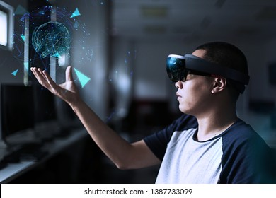 Young man test virtual reality glasses in the lab room with hololens headset 1. Future technology concept.