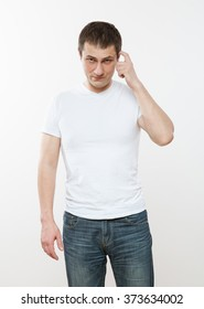 Young man thinking about something, white background