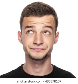 Young man thinking about something pleasant on white background.