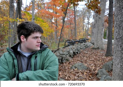Young Man in Thought with a Stonewall and Cannons and the Vibrant Colors of Autumn Leaves in the Background, Seminary Ridge, Gettysburg National Battlefield Park - October 31, 2016