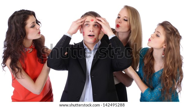 Young man with three girls and lipstick kiss-marks