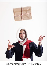A young man throw Christmas gifts