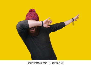 Young man throws dab on the background of a yellow wall
