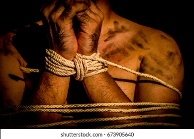 A young man with tied up and locked with rope in the abandoned building, Infringement hostage and the anti Human Trafficking concept.