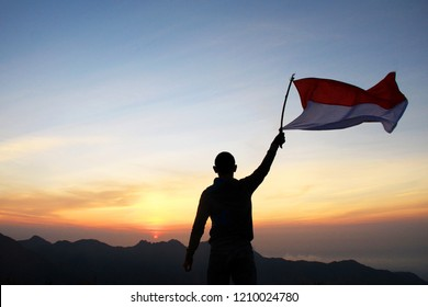 a young man is at the top of the mountain to commemorate the youth oath day in Indonesia.