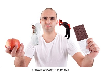 young man torn between eating an apple and a chocolate,between the devil and angel, on white