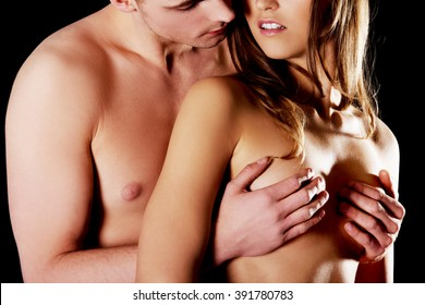 Young man touching woman's breast.