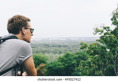 Young man tourist on the mountain in Kyiv, Ukraine