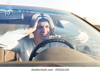young man in traffic congestion