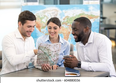 Young Man Travel Agent with Clients Concept