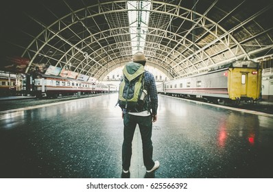 Young man traveler with  backpack Departure go to train. Travel concept.