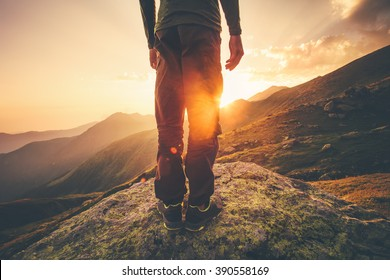 5eea623b02ae4 Young Man Traveler feet standing alone with sunset mountains on background  Lifestyle Travel concept outdoor