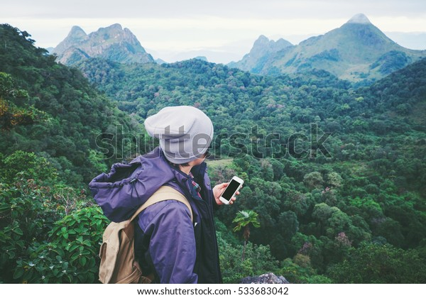 young man traveler He is using mobile phone travel concept