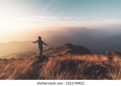 Young man traveler looking beautiful landscape at sunset on mountain, Adventure travel lifestyle concept