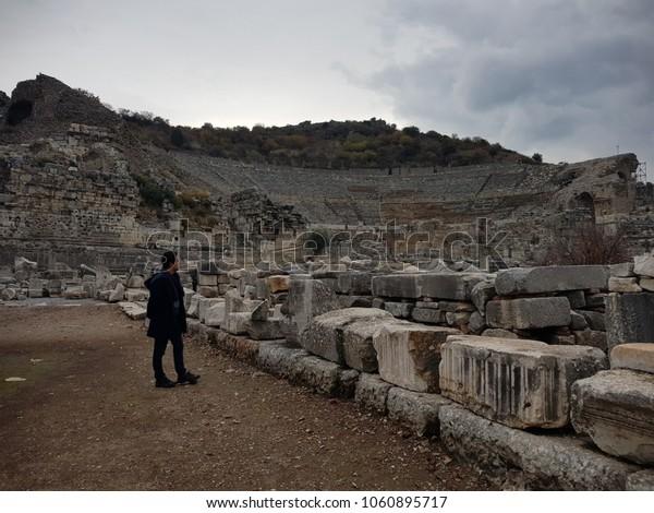 Young man traveler visiting the ruins of Ephesus in Izmir, Turkey