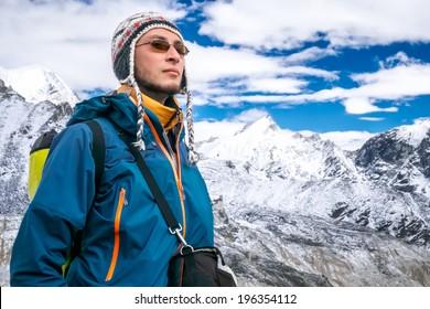 Young man trekking in Himalaya Mountains, Nepal