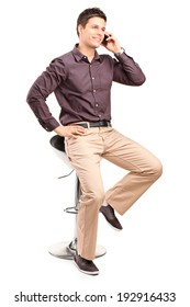 Young man in trendy clothes talking on the phone isolated on white background