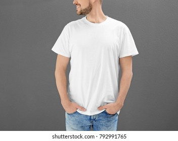 Young man in t-shirt on color background. Mockup for design