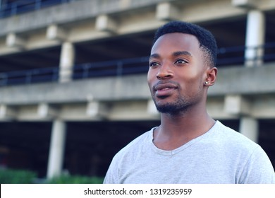 young man twenty outside parking staring looking and smiling sport portrait