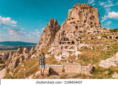 young man at Uchisar Castle Cappadocia Turkye during vacation Kapadokya hills