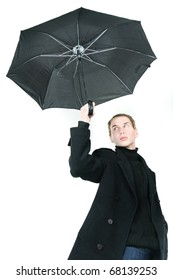 young man with umbrella over white