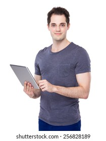 Young man use of digital tablet