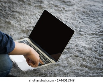 Young man use his finger press enter key on keyboard to waking computer from sleep mode.