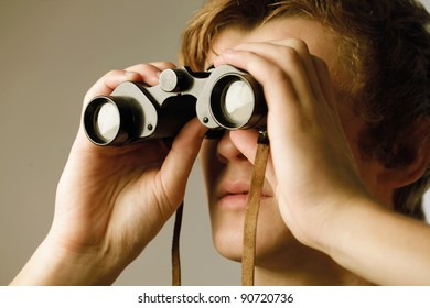 Young man using binoculars
