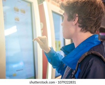 young man using huge touch screen panel close up portrait