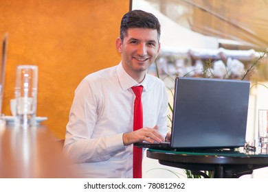 Young man using lap top in the cafe