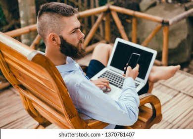 Young man using laptop in cafe near sea, tropical view, freelance work, outdoor hipster portrait, smartphone, paradise island, Bali, Thailand, beard man, instagram, bitcoin